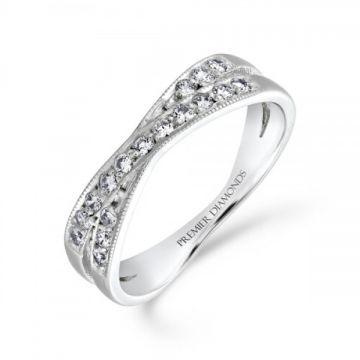 Elegant round brilliant cut diamond grain set with a milgrain edge crossover ring 0.17 carat