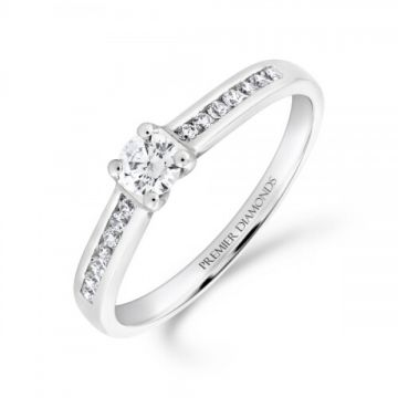 Stunning round brilliant cut four claw solitaire diamond engagement ring, with channel set diamond shoulders 0.40 carat