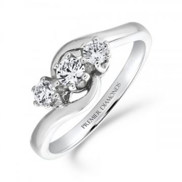 Traditional 3 stone round brilliant cut diamond trilogy ring set on a twist 0.36 carat