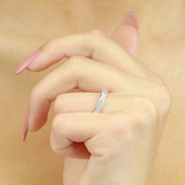 Pretty intertwined round brilliant cut three quarter set eternity ring 0.80 carat
