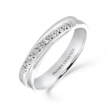 Elegant grain set round brilliant cut diamond crossover ring with milgrain edge 0.08 carat