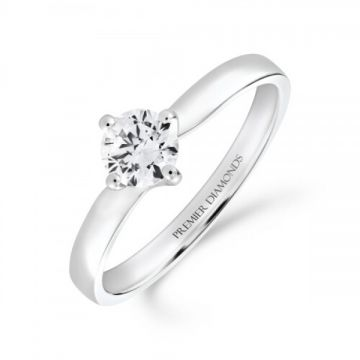 Sophisticated four claw round brilliant cut single stone diamond solitaire with a subtle twist 0.50 carat