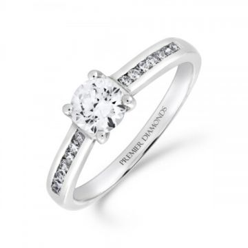 Stunning round brilliant cut four claw solitaire diamond engagement ring, with channel set diamond shoulders 0.65 carat