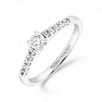Classic four claw round brilliant cut single stone diamond solitaire engagement ring with claw set diamond shoulders 0.40 carat