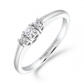 Elegant 3 stone round brilliant cut diamond trilogy ring set with four claws and a rounded shank 0.20 carat