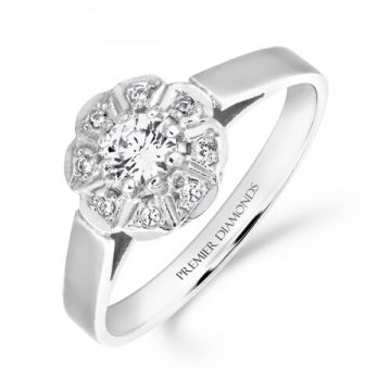 Traditional round brilliant cut diamond cluster ring with polished shoulders 0.30 carat